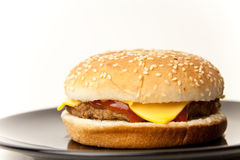 Cheeseburger served on a plate Stock Photos