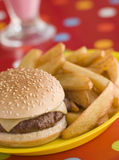 Cheeseburger in a Sesame Seed Bun with Chips Stock Photo