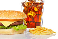 Cheeseburger, soda and french fries Stock Images