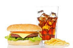 Cheeseburger, soda and french fries. Cheeseburger, soda drink and french fries, reflected on white background. Shallow DOF Stock Photo