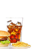 Cheeseburger, soda and french fries stock photos