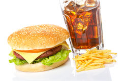 Cheeseburger, soda and french fries royalty free stock image