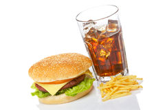 Cheeseburger, soda and french fries. Cheeseburger, soda drink and french fries, reflected on white background. Shallow depth of field Stock Photo