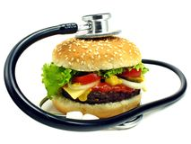 Cheeseburger & stethoscope Stock Images
