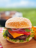 Cheeseburger on a summer picnic table Stock Photo