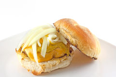 Cheeseburger Topped With Onions On A Toasted Hard Roll Stock Photo