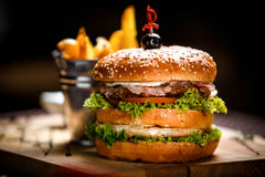 Cheeseburger on a wooden board Royalty Free Stock Image