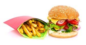 Cheeseburger y fritadas Fotografía de archivo libre de regalías