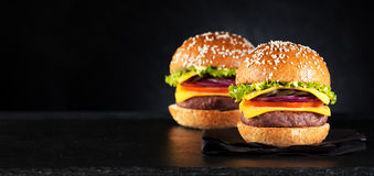 Cheeseburgers гамбургеров бургеров Стоковое Фото