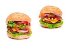 Cheeseburgers изолированные на белизне Стоковая Фотография