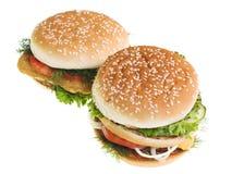 cheeseburgers предпосылки изолировали белизну Стоковое Фото