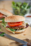Cheeseburgers with arugula salad on a table Stock Image
