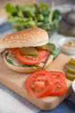 Cheeseburgers with arugula salad on a table Royalty Free Stock Photo