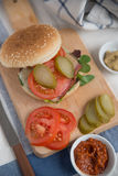 Cheeseburgers with arugula salad on a table Royalty Free Stock Image