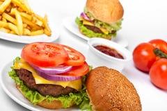 cheeseburgers dłoniaki Obrazy Stock