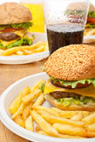 Cheeseburgers, fries and drinks Stock Photo