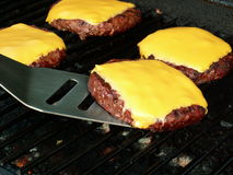 Cheeseburgers On Grill Stock Image