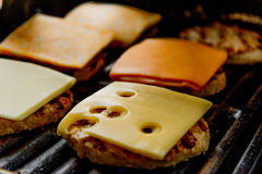 Cheeseburgers on the grill Royalty Free Stock Photo