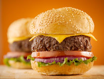 Cheeseburgers on wooden board. Stock Photo