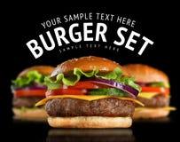 Cheeseburgersatz Stockfotografie