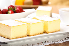 Cheesecak with a cap of coffee. The composition of delicious cheesecake served with strawberries Stock Images