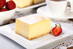 Cheesecak with a cap of coffee Royalty Free Stock Image