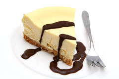 Cheesecake. Baked cheesecake with chocolate sauce Stock Images