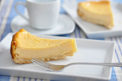 Cheesecake. Two slices of Cheesecake with a cup of Coffee Royalty Free Stock Image