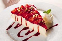 Cheesecake. With strawberries and ice cream Stock Photos