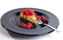Cheesecake. Slice of cheesecake on blue plate royalty free stock photos