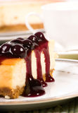 Cheesecake. A delicious slice of cheesecake with Chocolate topping Royalty Free Stock Photography