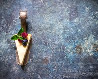 Cheesecake with berries on blue slate background. Stock Images