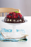 Cheesecake with berries on a brownie layer Stock Photo