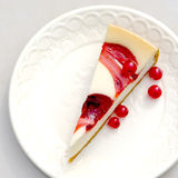 Cheesecake, berries. Good quality photo of a cheesecake lying on milky white ceramic plate. There's classic cheesecake with berry jam. Light sweetness of Stock Photography