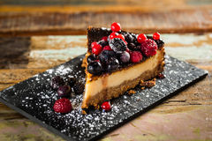 Cheesecake with berries Stock Photos