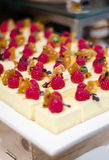 Cheesecake bites. Cheesecake with raspberries and caramel-  finger-food Stock Images