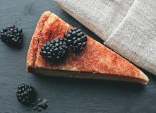 Cheesecake with blackberries Stock Photos