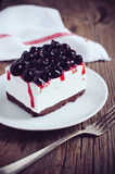 Cheesecake with blackberry. Fresh tasty cheesecake with blackberry on a plate, creamy dessert Stock Photography