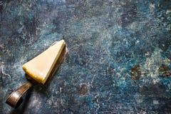 Cheesecake on blue slate background. Royalty Free Stock Photos