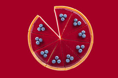 Cheesecake with blueberries on a red background Stock Photography