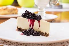Cheesecake with blueberry jam. Dessert, slice of cheesecake with blueberry jam Stock Photo