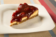 Cheesecake with brazilian goiabada jam of guava on plate on tabl. E Royalty Free Stock Images