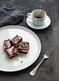 Cheesecake brownie squares with raspberries and Stock Image