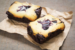 Cheesecake brownies on brown paper Stock Photography