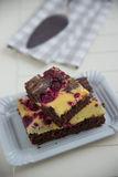 Cheesecake brownies with raspberry Stock Photography
