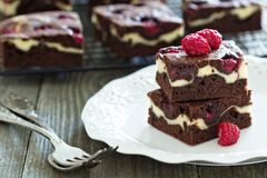 Cheesecake brownies with raspberry Stock Images