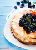 Cheesecake with caramel and berries Stock Photos
