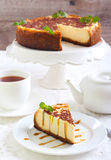 Cheesecake with caramel drizzle Royalty Free Stock Photography