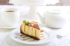 Cheesecake with caramel drizzle,. Served on plate Royalty Free Stock Photography