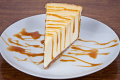 Cheesecake With Caramel Drizzled Royalty Free Stock Photography